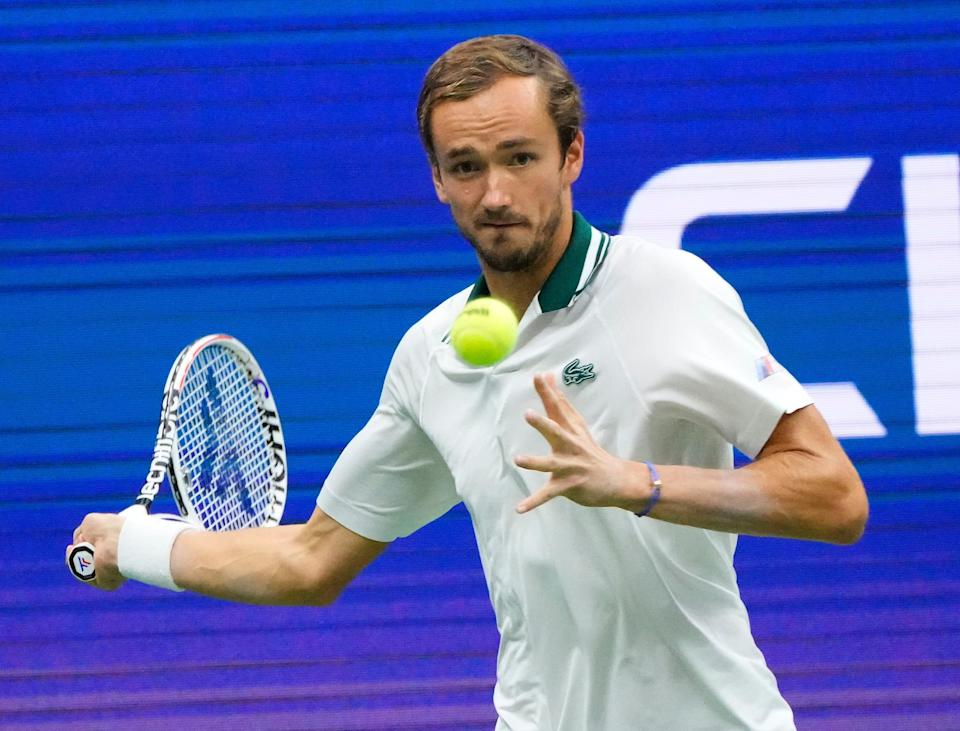 No. 2 seed Daniil Medvedev hits a forehand to Daniel Evans during their fourth-round match.
