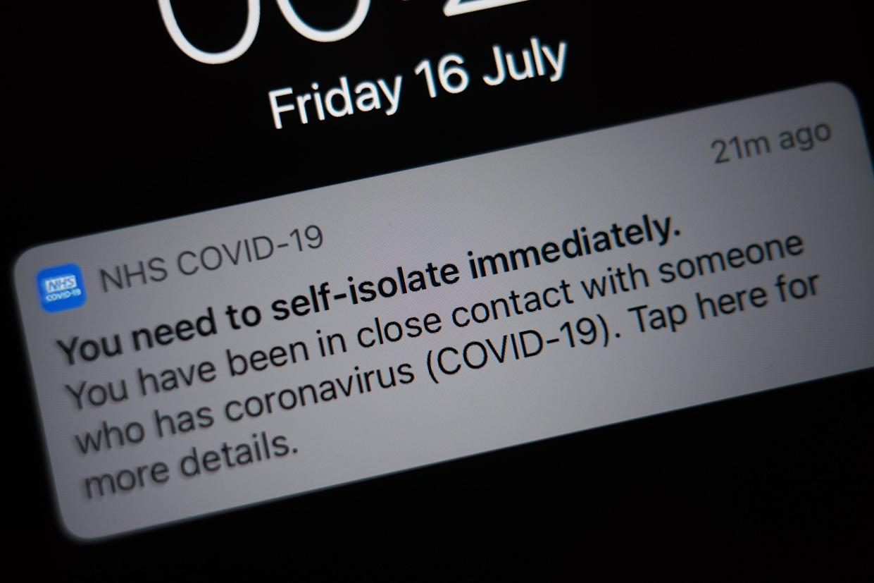 A notification issued by the NHS coronavirus contact tracing app - informing a person of the need to self-isolate immediately, due to having been in close contact with someone who has coronavirus - is displayed on a mobile phone in London, during the easing of lockdown restrictions in England. Picture date: Friday July 16, 2021. (Photo by Yui Mok/PA Images via Getty Images)