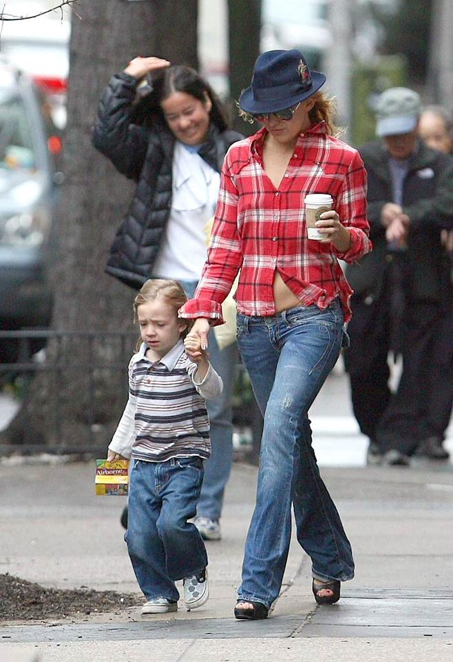 """Kate Hudson keeps her four-year-old son Ryder close while encountering stiff winds in New York City. <a href=""""http://www.infdaily.com"""" target=""""new"""">INFDaily.com</a> - April 1, 2008"""