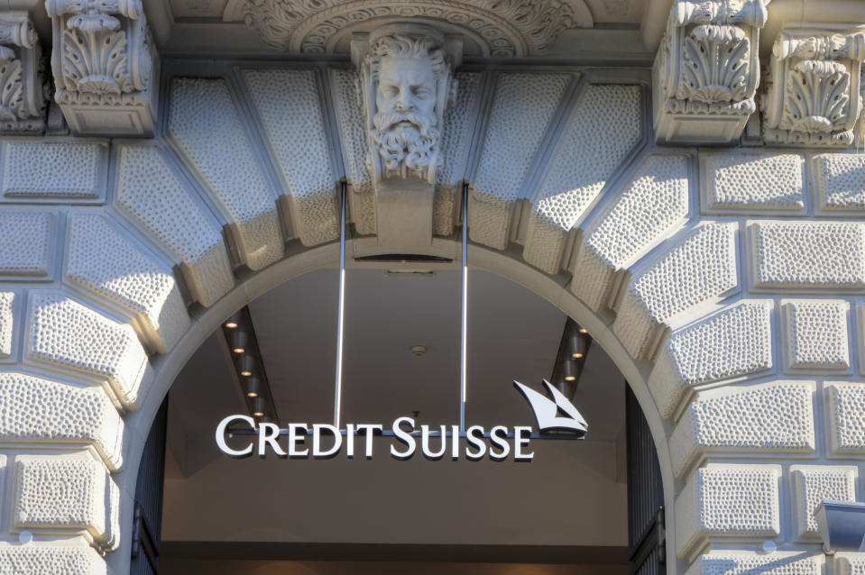 Zurich, Switzerland - May 18, 2011: The Credit Suisse logo hangs in the main entrance to the Credit Suisse building on the Paradeplatz in Zurich.
