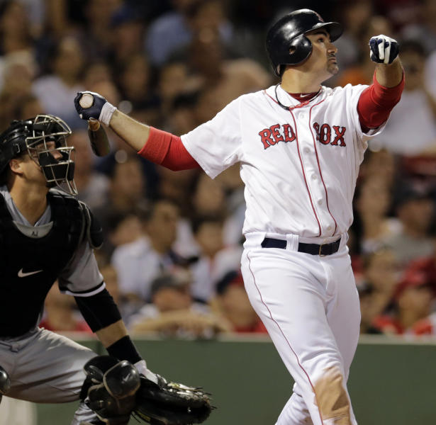Boston Red Sox's Adrian Gonzalez watchs the flight of his three-run home run in the eighth inning of a baseball game against the Chicago White Sox at Fenway Park in Boston, Monday, July 16, 2012. At left is White Sox catcher A.J. Pierzynski. (AP Photo/Charles Krupa)