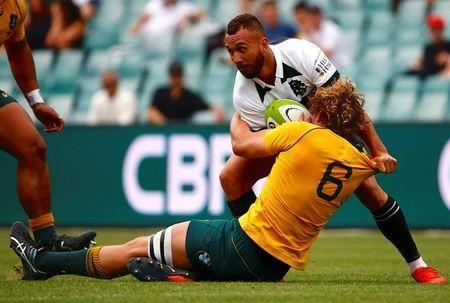 FILE PHOTO: Rugby Union - Australia Wallabies vs Barbarians - Sydney Football Stadium, Sydney, Australia, October 28, 2017. Australia's Ned Hanigan tackles Quade Cooper of the Barbarians. REUTERS/David Gray