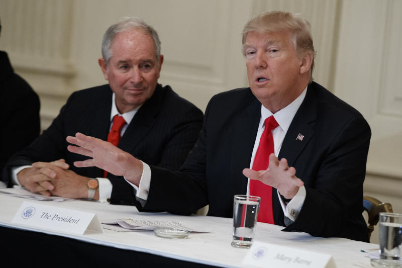 Blackstone CEO Stephen Schwarzman listens at left as President Donald Trump speaks during a meeting with business leaders in the State Dining Room of the White House in Washington, Friday, Feb. 3, 2017. (AP Photo/Evan Vucci)