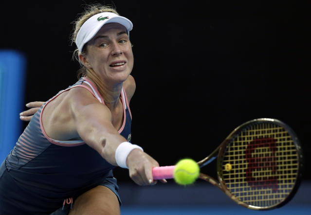 Russia's Anastasia Pavlyuchenkova makes a backhand return to United States' Danielle Collins during their quarterfinal match at the Australian Open tennis championships in Melbourne, Australia, Tuesday, Jan. 22, 2019. (AP Photo/Kin Cheung)