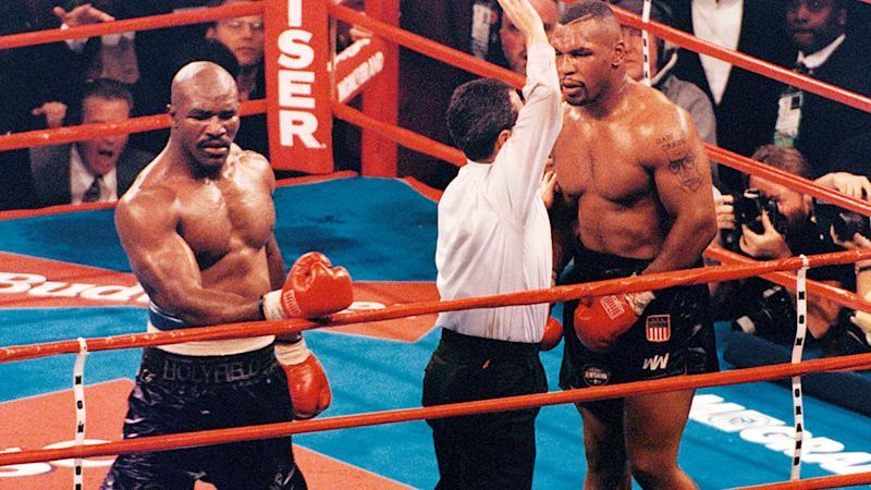 Evander Holyfield and Mike Tyson, pictured here during a bout in 1996.