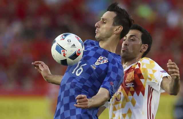 FILE - In this June 21, 2016 file photo Croatia's Nikola Kalinic, left, is challenged by Spain's Sergio Busquets during the Euro 2016 Group D soccer match between Croatia and Spain at the Nouveau Stade in Bordeaux, France. (AP Photo/Petr David Josek, file)