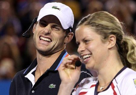 """Andy Roddick of the U.S and Kim Clijsters of Belgium laugh during a fundraising exhibition """"Hit for Haiti"""" for the victims of the Haiti earthquake ahead of the Australian Open tennis tournament in Melbourne January 17, 2010.   REUTERS/Mick Tsikas"""