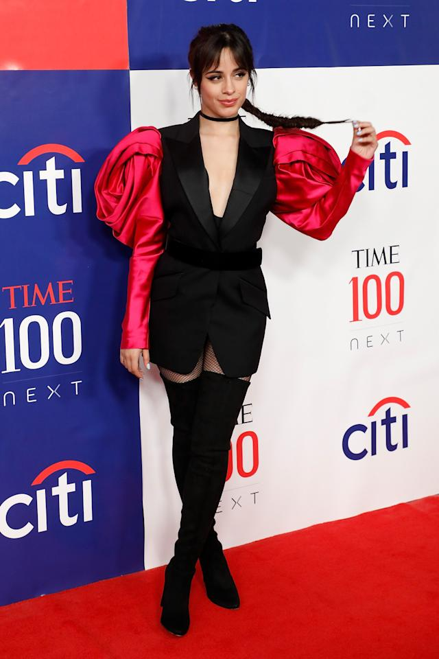 There's <em>a lot</em> of style happening here. From turning boots into pants to her oversized sleeves, Camila made this look entirely her own.