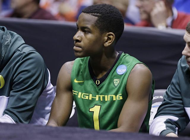 Oregon guard Dominic Artis (1) reacts as he sits in the bench during the second half of a regional semifinal against Louisville in the NCAA college basketball tournament, Friday, March 29, 2013, in Indianapolis. Louisville won 77-69. (AP Photo/Michael Conroy)