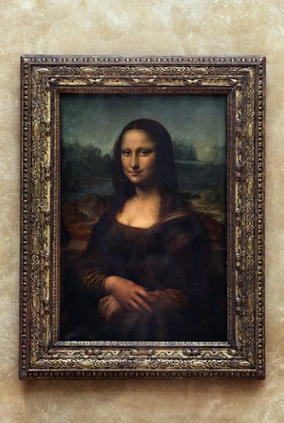 Mona Lisa's portrait appears to many to be smiling sweetly at first, only to adopt a mocking sneer or sad stare the longer you look (AFP Photo/JEAN-PIERRE MULLER)
