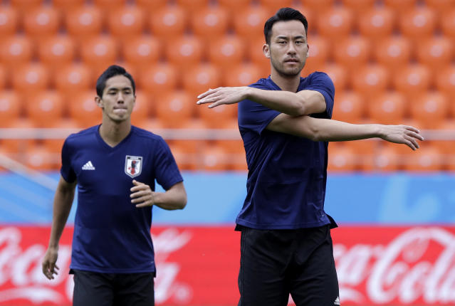 Japan's Maya Yoshida stretches during the official training on the eve of the group H match between Japan and Senegal at the 2018 soccer World Cup in the Yekaterinburg Arena in Yekaterinburg, Russia, Saturday, June 23, 2018. (AP Photo/Mark Baker)