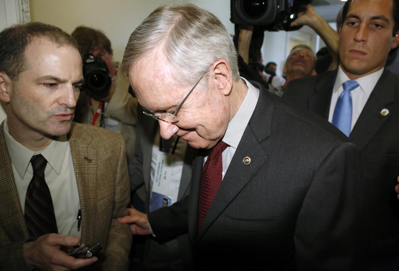 U.S. Senate Majority Leader Harry Reid (D-NV) (C) departs after a news conference at the U.S. Capitol in Washington, September 30, 2013. Senate Democrats killed a proposal by the Republican-led House of Representatives to delay Obamacare for a year in return for temporary funding of the federal government. The bill now goes back to the House, where its fate is unknown. REUTERS/Jonathan Ernst (UNITED STATES - Tags: POLITICS BUSINESS)