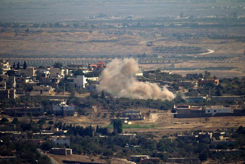 Seen from the hill village of Buqaata in the Israeli-annexed Golan Heights, smoke ascends from alleged shelling by Syrian government forces in the Syrian village of Jubata al-Khashab, on September 27, 2015