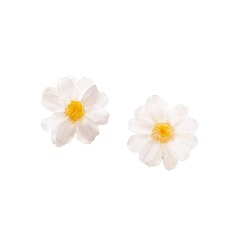 """$156, I'MMANY London. <a href=""""https://www.immany.co.uk/collections/earrings/products/real-flower-paris-daisy-stud-earrings"""" rel=""""nofollow noopener"""" target=""""_blank"""" data-ylk=""""slk:Get it now!"""" class=""""link rapid-noclick-resp"""">Get it now!</a>"""