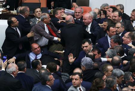 Lawmakers from ruling AK Party and the main opposition Republican People's Party (CHP) scuffle during a debate on the proposed constitutional changes at the Turkish Parliament in Ankara, Turkey, January 12, 2017. REUTERS/Stringer