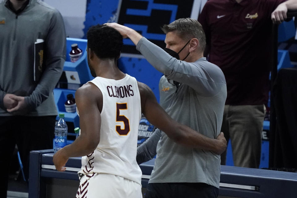 Loyola Chicago head coach Porter Moser, right, reacts with guard Keith Clemons (5) after a Sweet 16 game against Oregon State in the NCAA men's college basketball tournament at Bankers Life Fieldhouse, Saturday, March 27, 2021, in Indianapolis. Oregon State won 65-58. (AP Photo/Jeff Roberson)