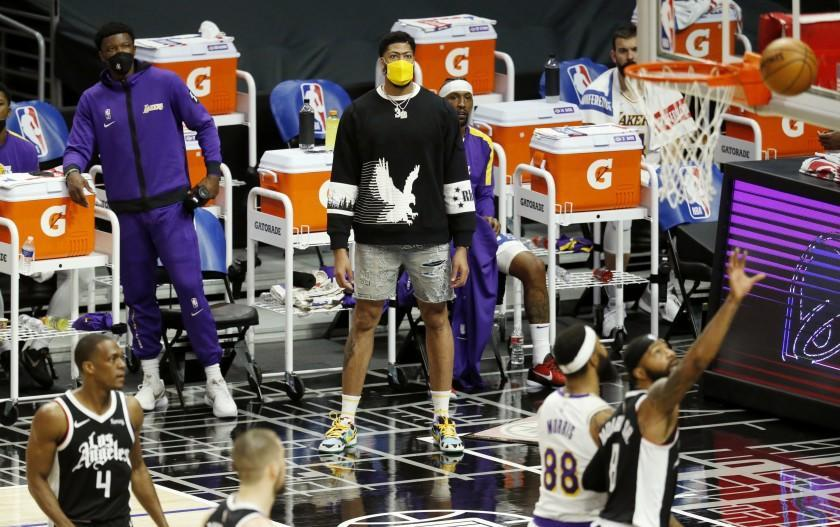 LOS ANGELES, CA - APRIL 04: Los Angeles Lakers forward Anthony Davis (3), injured, looks on from the sideline while the Lakers play the LA Clippers in the first quarter at the Staples Center on Sunday, April 4, 2021 in Los Angeles, CA. (Gary Coronado / Los Angeles Times)