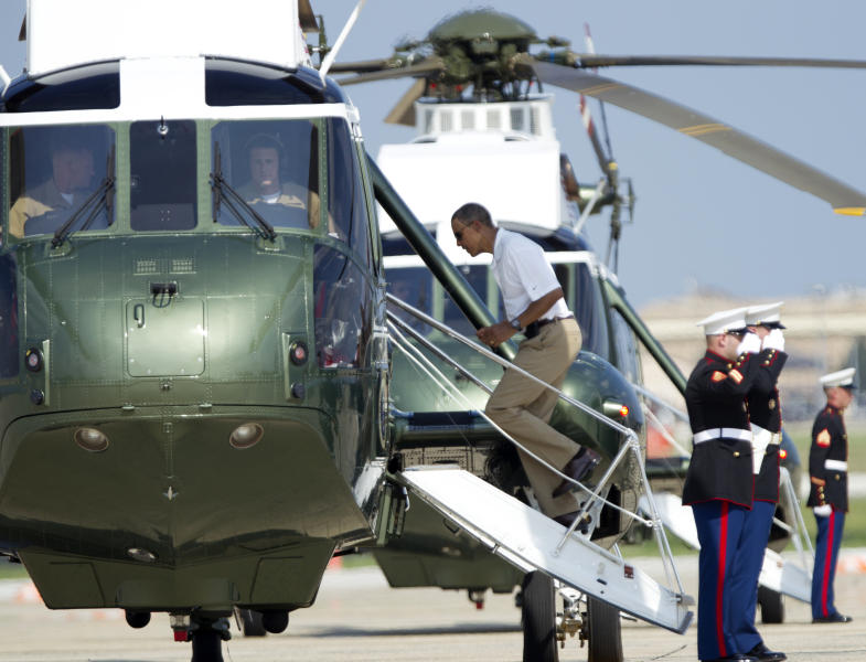 President Barack Obama boards Marine One helicopter as he departs Andrews Air Force Base, Md., for Camp David, Saturday, Aug. 4, 2012. President Obama celebrated his 51st birthday Saturday with a round of golf and plans for a quiet weekend at Camp David, taking a break from campaigning three months before election day. (AP Photo/Manuel Balce Ceneta)