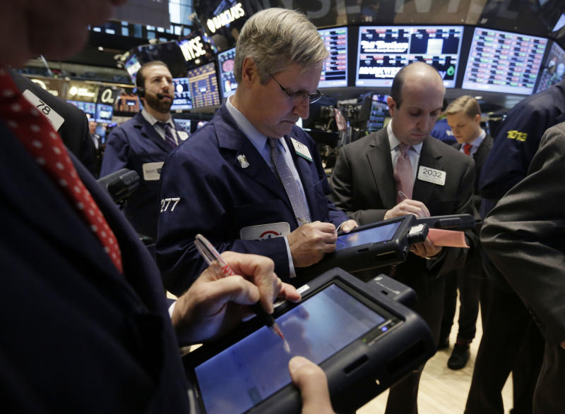 Traders work on the floor of the New York Stock Exchange Wednesday, Feb. 5, 2014. The U.S. stock market is edging lower in early trading after a modest recovery the day before. (AP Photo/Richard Drew)