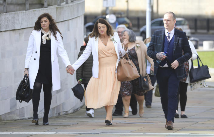 Relatives arrive for the inquest into the Ballymurphy shooting, in Belfast, Northern Ireland, Tuesday May 11, 2021. The findings of the inquest into the deaths of 10 people during an army operation in August 1971 is due to be published on Tuesday. (AP Photo/Peter Morrison)