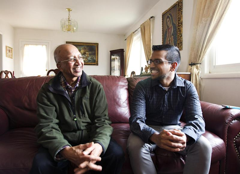 "Yves Gomes, a student at the University of Maryland, who's parents were deported, right, talks to his great uncle Henry Gomes, in his great uncle's house where he lives, in Silver Spring, Md., Friday Jan. 17, 2014. Gomes says he considers himself one of the lucky ones _ lucky, at least, among the so-called ""DREAMers."" Even though his parents were deported and his legal status was once in limbo, today the 21-year-old Indian native attends the University of Maryland paying in-state tuition. ( AP Photo/Jose Luis Magana)"