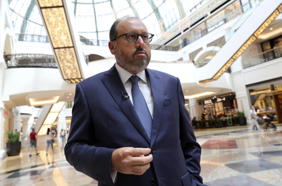 Alain Bejjani, CEO of the Majid Al Futtaim Group, talks to The Associated Press at the Mall of the Emirates in Dubai, United Arab Emirates, Thursday, April 15, 2021. The Middle East's largest operator of malls, Majid Al Futtaim, expects revenue and earnings to climb back to pre-pandemic levels by the end of next year and is moving full steam ahead with plans to develop its biggest mall ever. (AP Photo/Kamran Jebreili)