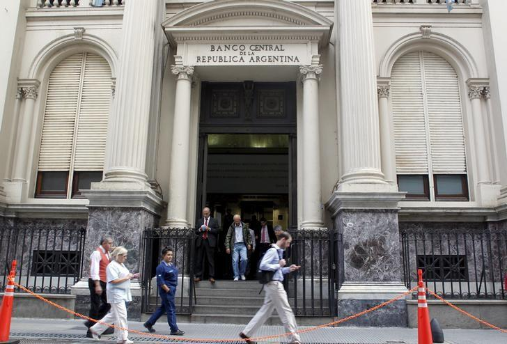 Pedestrians past by Argentina's Banco Central Bank in Buenos Aires' financial district