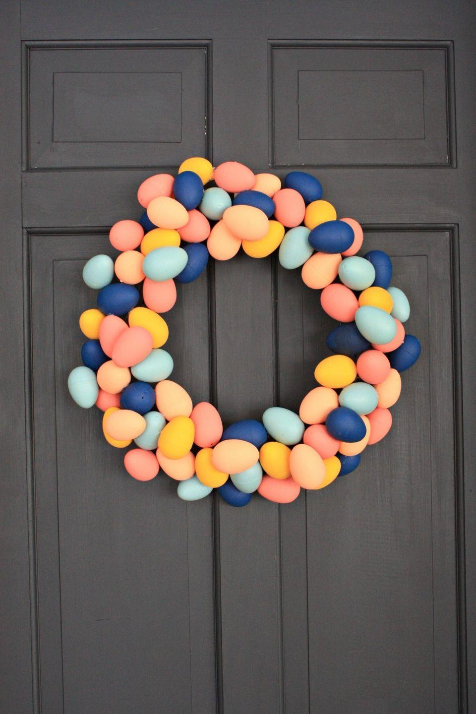 """<p>If you have some plastic eggs lying around the house, consider coating them in pretty paint colors and attaching them to a wreath. </p><p><strong>Get the tutorial at <a href=""""https://one-thousandoaks.com/diy-egg-wreath-for-spring"""" rel=""""nofollow noopener"""" target=""""_blank"""" data-ylk=""""slk:One Thousand Oaks"""" class=""""link rapid-noclick-resp"""">One Thousand Oaks</a>.</strong></p><p><a class=""""link rapid-noclick-resp"""" href=""""https://go.redirectingat.com?id=74968X1596630&url=https%3A%2F%2Fwww.walmart.com%2Fip%2FExpert-Grill-12-Natural-Bamboo-Skewers-for-Grilling-100-Count%2F996635765&sref=https%3A%2F%2Fwww.thepioneerwoman.com%2Fhome-lifestyle%2Fcrafts-diy%2Fg35698457%2Fdiy-easter-wreath-ideas%2F"""" rel=""""nofollow noopener"""" target=""""_blank"""" data-ylk=""""slk:SHOP WOODEN SKEWERS"""">SHOP WOODEN SKEWERS</a></p>"""