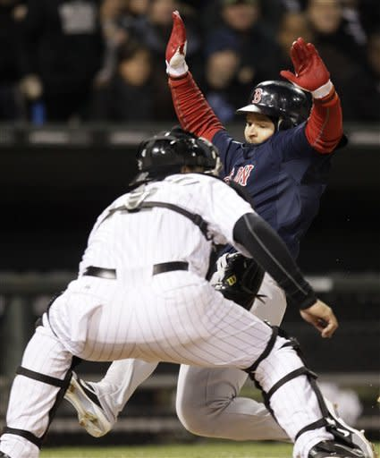 Boston Red Sox's Cody Ross, right, is safe at home as Chicago White Sox catcher A.J. Pierzynski waits for the ball during the sixth inning of a baseball game in Chicago, Friday, April 27, 2012. (AP Photo/Nam Y. Huh)