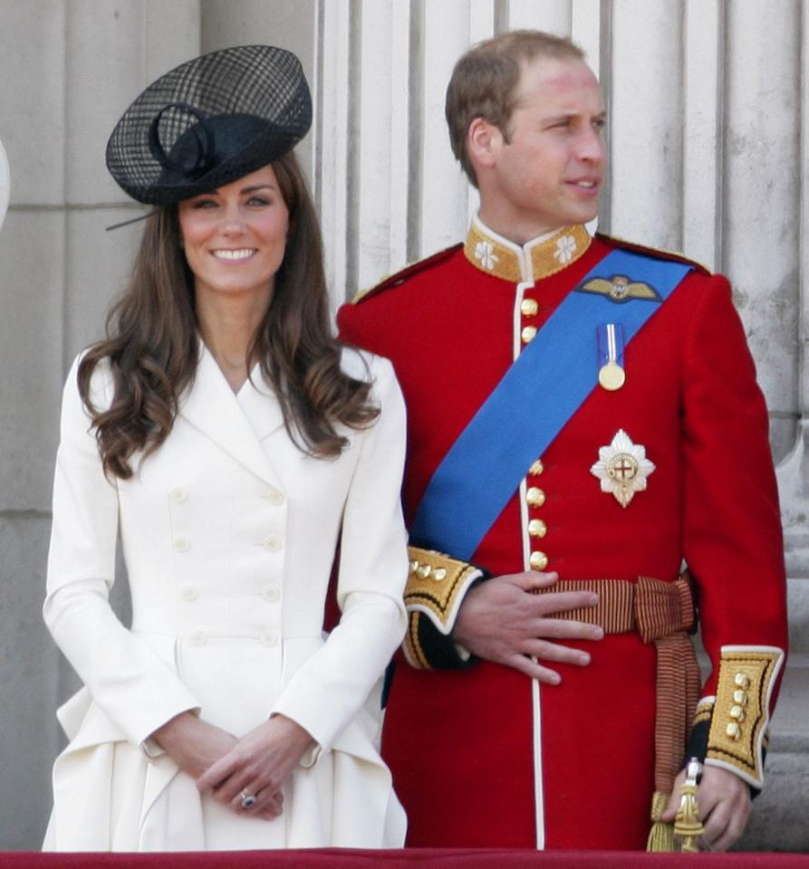 <p>Her dress/coat was made by Alexander McQueen and featured a tiered skirt and padded shoulders.</p>