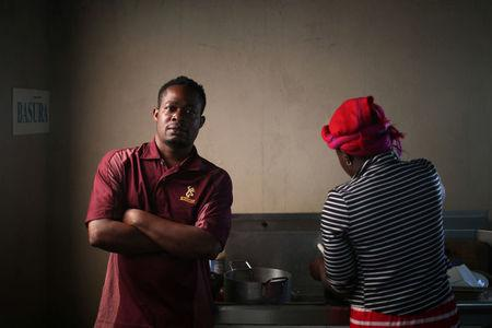 Haitian migrant, Normilus Mondesir, 38, poses for a photo inside the kitchen of the Juventud 2000 shelter after leaving Brazil, where he relocated to after Haiti's 2010 earthquake, in Tijuana, Mexico, October 7, 2016. REUTERS/Edgard Garrido