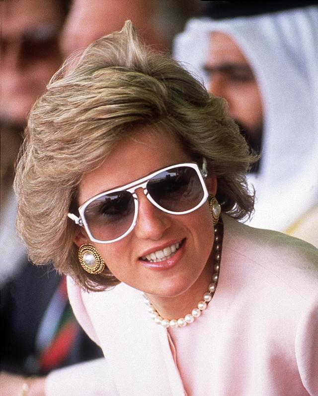 <p>Another posh look Princess Diana brought to the hoi polloi was her love of giant sunnies. Great for concealing dark circles and disdain for your husband. (Photo: Jayne Fincher/Getty Images) </p>