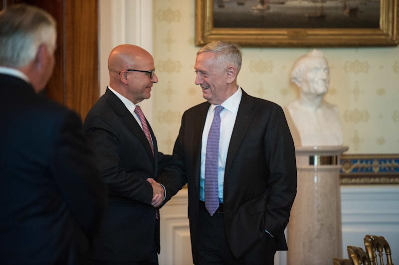 U.S. Defense Secretary Jim Mattis, at right, shakes hands with national security adviser H.R. McMaster.