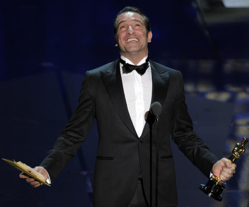 "Jean Dujardin accepts the Oscar for best actor in a leading role for ""The Artist"" during the 84th Academy Awards on Sunday, Feb. 26, 2012, in the Hollywood section of Los Angeles. (AP Photo/Mark J. Terrill)"