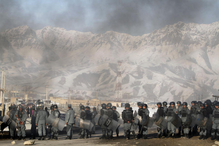 Afghan policemen form a line during an anti-U.S. demonstration in Kabul, Afghanistan, Friday, Feb. 24, 2012. Thousands of Afghans staged new demonstrations Friday over the burning of Qurans at a U.S. military base in Afghanistan. (AP Photo/Musadeq Sadeq)