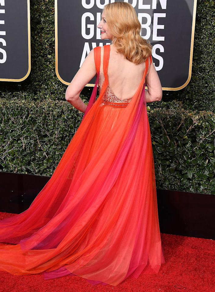 in an orange-ombre Georges Chakra gown to the Golden Globe Awards.