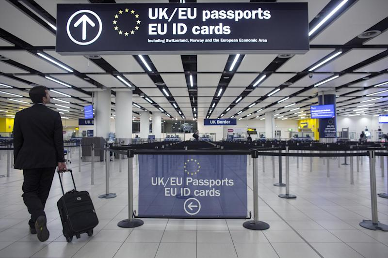 Border Force check the passports of passengers arriving at Gatwick Airport: Getty Images