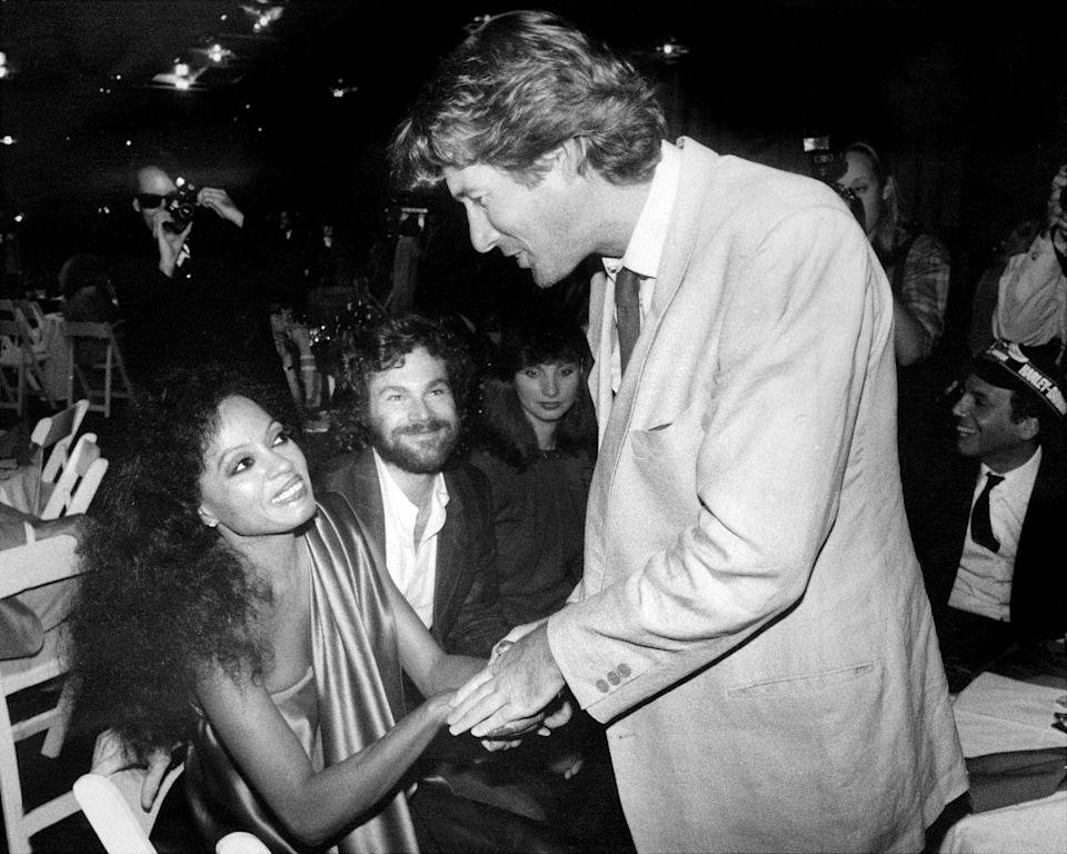 <p>Actor Richard Gere greets legendary singer, Diana Ross, after attending one of her concerts in 1984. The pair are seen onboard New York's Intrepid for her concert after-party. </p>
