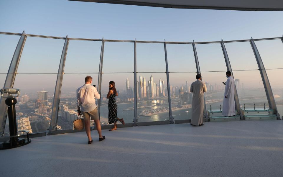 Visitors wore face masks on the 52nd floor of the Palm Tower in Dubai - Shutterstock