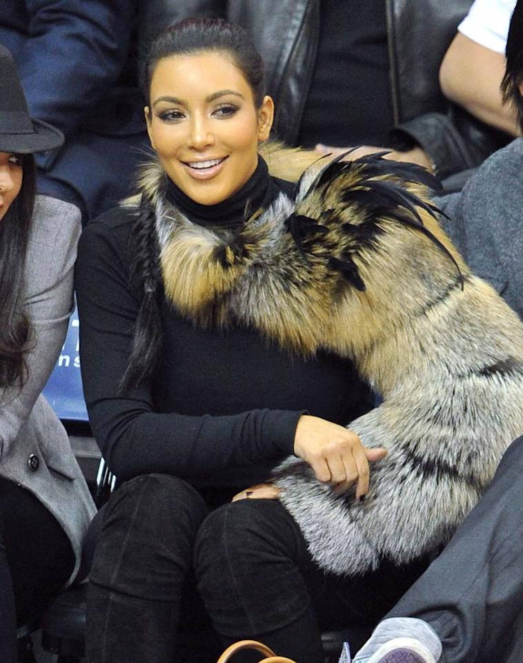"""The final Kardashian in this week's What Were They Thinking?! gallery ... middle sis Kim, who sat courtside at a pro basketball game in something we've never seen before and hope to never see again: a fur-and-feather arm warmer. James Devaney/<a href=""""http://www.wireimage.com"""" target=""""new"""">WireImage.com</a> - October 31, 2010"""