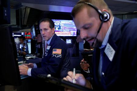 Traders work on the floor of the New York Stock Exchange (NYSE) in Manhattan in New York