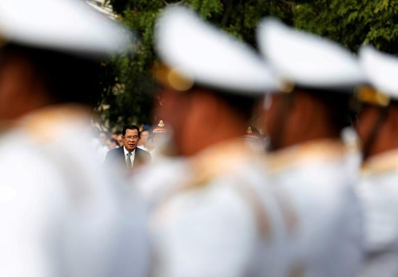 FILE PHOTO: Cambodia's Prime Minister Hun Sen attends a celebrations marking the 66th anniversary of the country's independence from France, in central Phnom Penh