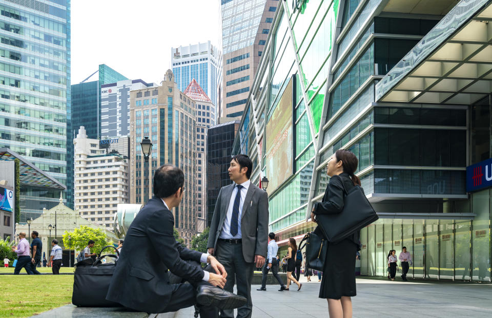 Singapore, 15 January 2019 : office worker and tourist in front of Raffles Place, Central Business District.'