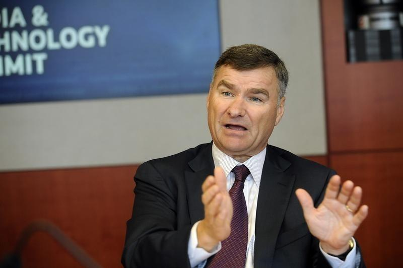 Michael White, CEO of DirecTV, speaks during the Reuters Media and Technology Summit in New York