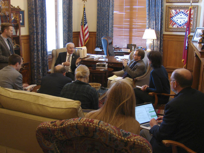 Gov. Asa Hutchinson visits with reporters at his State Capitol office in Little Rock, Arkansas, on Thursday, Jan. 26, 2017, to discuss a bill limiting a common second-trimester abortion procedure. The Arkansas Senate gave the bill final approval Thursday, and Hutchinson said he would sign the bill when it arrives in his office. (AP Photo/Kelly P. Kissel)