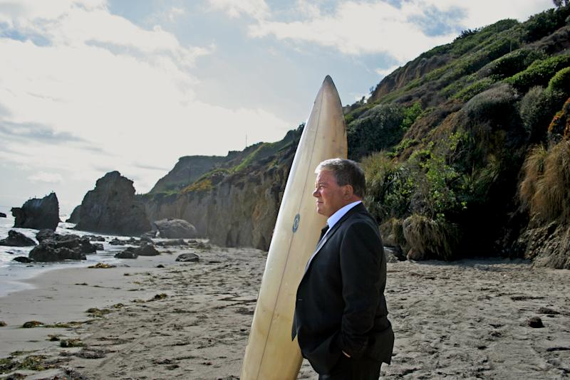 This image released by Priceline.com shows William Shatner on a beach during a commercial for Priceline.com. Seven months after a commercial showed Shatner, as the Negotiator, plunging off a cliff and into apparent oblivion, the company is resurrecting him in a new 30-second TV and online spot set to debut Thursday, Aug. 16.  (AP Photo/Priceline.com, Susan Smith)