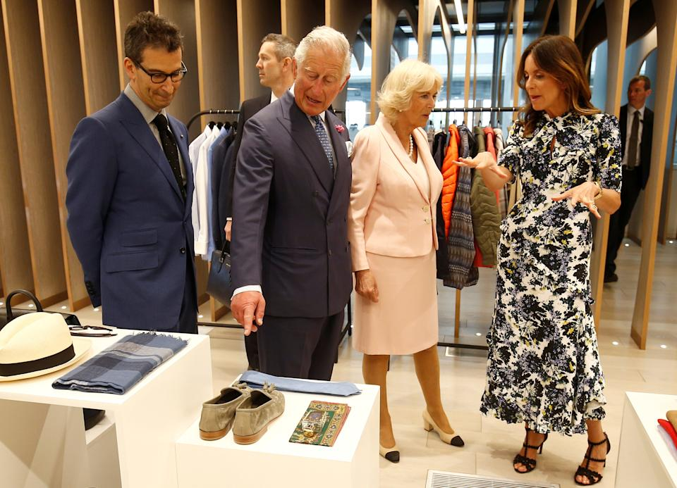 LONDON, ENGLAND - MAY 16:  Camilla, Duchess of Cornwall and Prince Charles, Prince of Wales tour the new Tech Hub, with British Fashion Council Chief Executive Caroline Rush and Chief Executive of Yoox Net-a-Porter Group Federico Marchetti at the Yoox Net-a-Porter Group offices on May 16, 2018 in London England. (Photo by Henry Nicholls - WPA Pool/Getty Images)