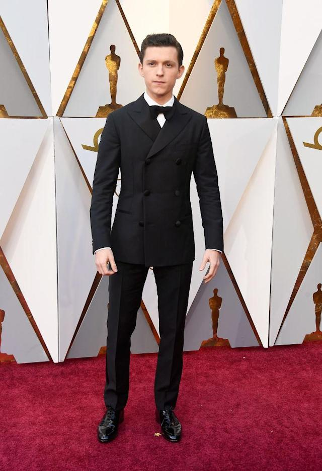 <p>Tom Holland attends the 90th Academy Awards in Hollywood, Calif., March 4, 2018. (Photo: Getty Images) </p>