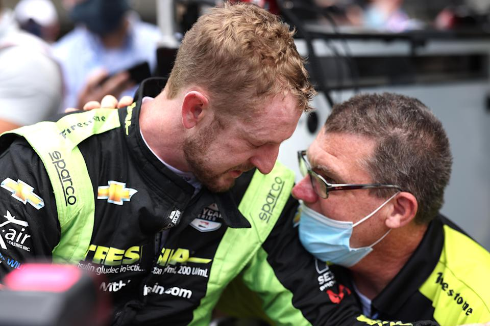 <em>Charlie Kimball is consoled by an AJ Foyt Racing team member after failing to qualify (Chris Owens/IndyCar).</em>