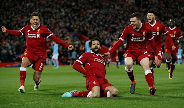 <p>Soccer Football – Champions League Quarter Final First Leg – Liverpool vs Manchester City – Anfield, Liverpool, Britain – April 4, 2018 Liverpool's Mohamed Salah celebrates with Roberto Firmino and Andrew Robertson after scoring their first goal REUTERS/Andrew Yates </p>